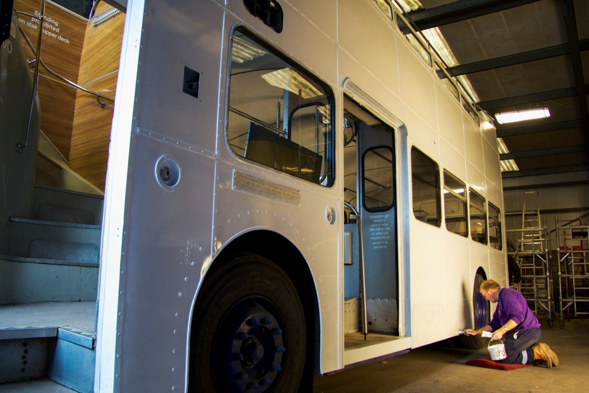 Coach painting a bus