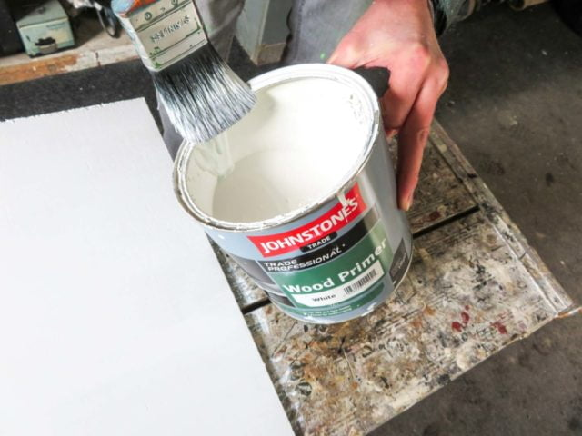 Wiping excess paint from a brush