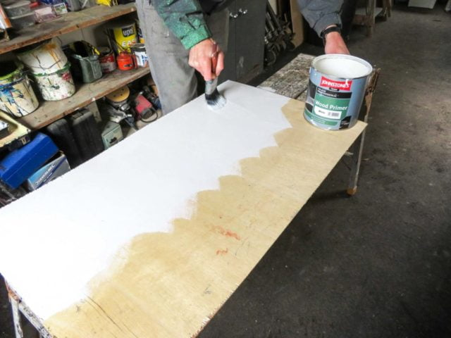 Brushing paint on by hand