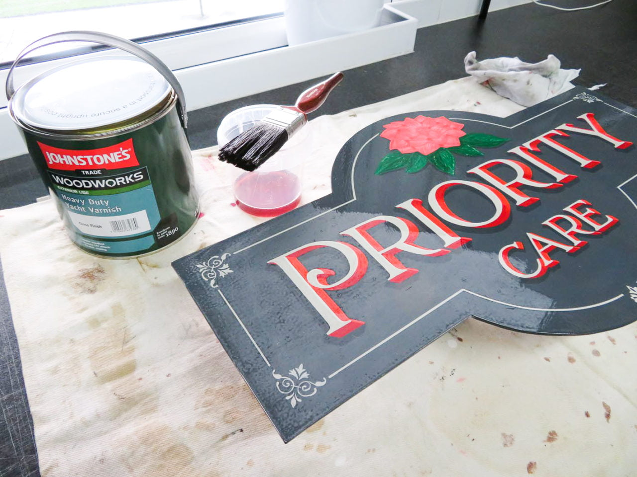 Varnishing hand lettered sign