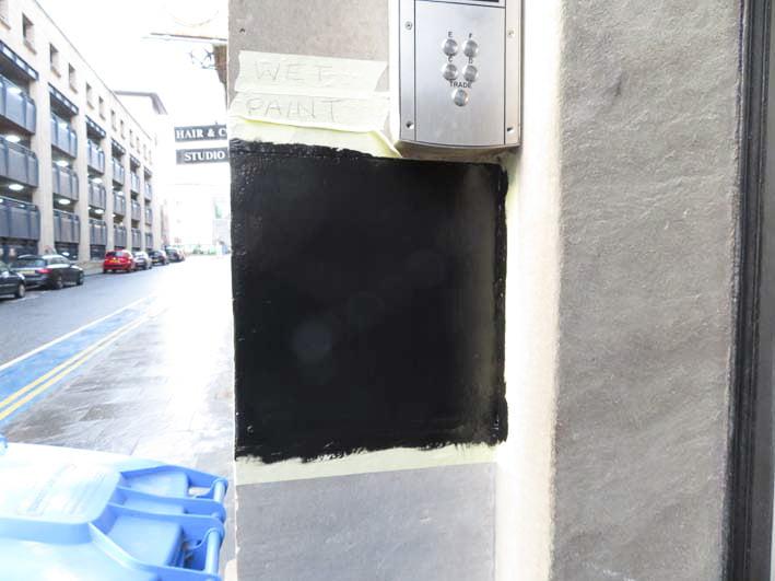 Black wall sign