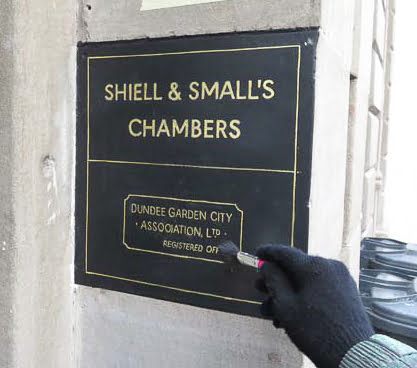 Remove excess gold leaf on the wall sign