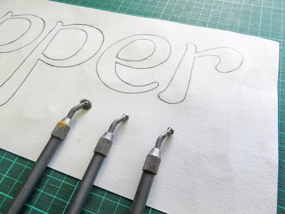signwriting using pounce wheels